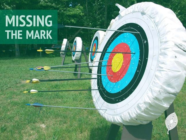 Featured image for this post; arrows in a target